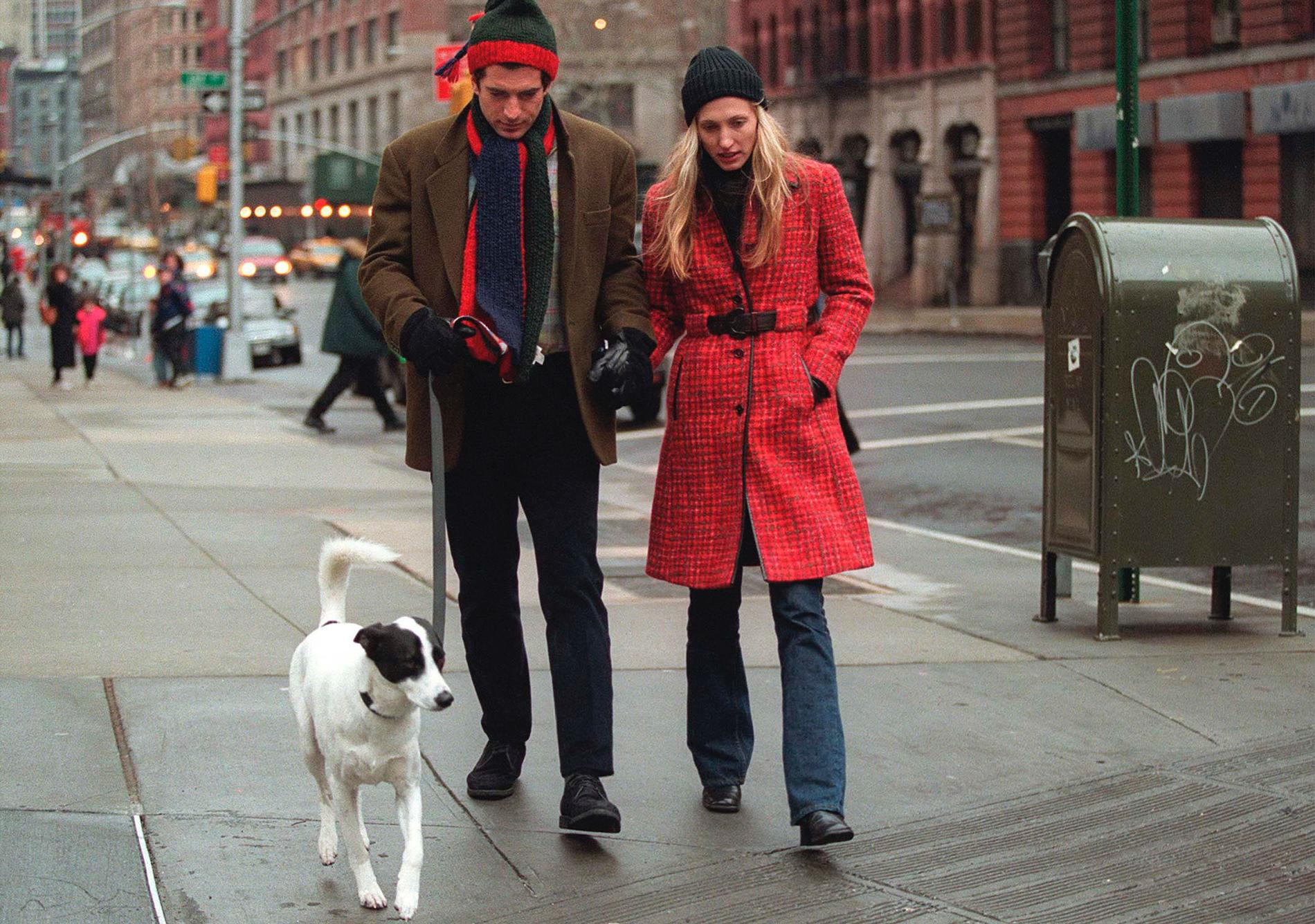 292061 08: (MAGAZINES PLEASE CALL) John F. Kennedy Jr. and his wife Carolyn walk with their dog January 1, 1997 in New York City. July 16, 2000 marks the one-year anniversary of the plane crash off the coast of Martha's Vineyard in Massachusetts that killed John F. Kennedy Jr., 38, his wife Carolyn Bessette Kennedy, 33, and her sister Lauren Bessette, 34. (Photo by Evan Agostini/Liaison)